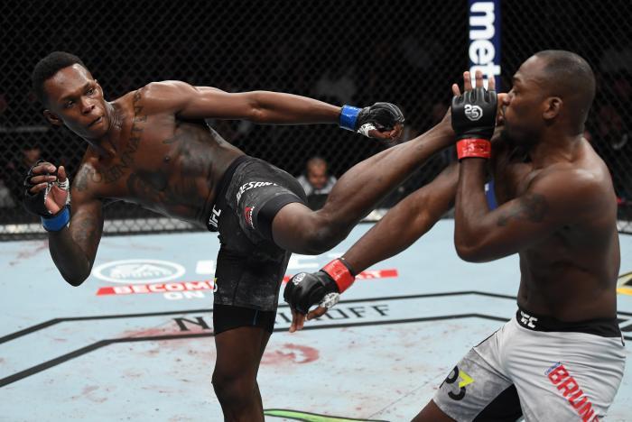 NEW YORK, NY - NOVEMBER 03:  (L-R) Israel Adesanya of Nigeria kicks Derek Brunson in their middleweight bout during the UFC 230 event inside Madison Square Garden on November 3, 2018 in New York, New York. (Photo by Jeff Bottari/Zuffa LLC via Getty Images)