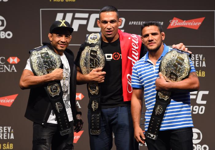 RIO DE JANEIRO, BRAZIL - JULY 31:  (L-R) UFC featherweight champion Jose Aldo, UFC heavyweight champion Fabricio Werdum, and UFC lightweight champion Rafael Dos Anjos pose for a picture during the UFC 190 weigh-in inside HSBC Arena on July 31, 2015 in Rio de Janeiro, Brazil.  (Photo by Josh Hedges/Zuffa LLC/Zuffa LLC via Getty Images)