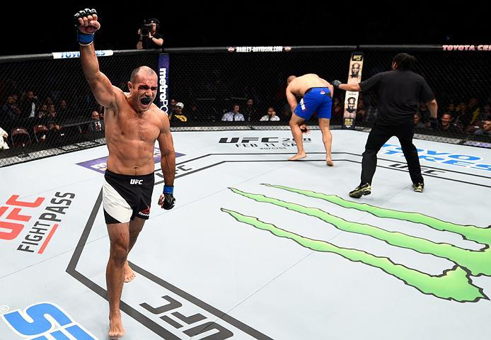 HOUSTON, TX - FEBRUARY 04:  (L-R) Marcel Fortuna of Brazil celebrates his knockout victory over Anthony Hamilton in their heavyweight bout during the UFC Fight Night event at the Toyota Center on February 4, 2017 in Houston, Texas. (Photo by Jeff Bottari/