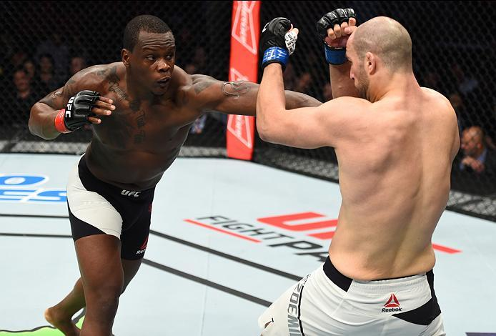HOUSTON, TX - FEBRUARY 04:  (L-R) Ovince Saint Preux punches Volkan Oezdemir of Switzerland in their light heavyweight bout during the UFC Fight Night event at the Toyota Center on February 4, 2017 in Houston, Texas. (Photo by Jeff Bottari/Zuffa LLC/Zuffa