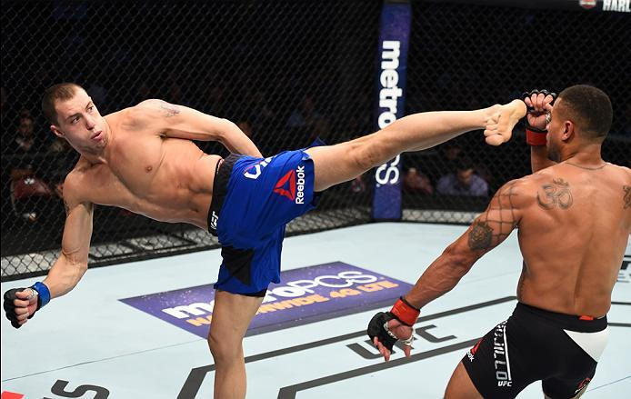 HOUSTON, TX - FEBRUARY 04:  (L-R) James Vick kicks Abel Trujillo in their lightweight bout during the UFC Fight Night event at the Toyota Center on February 4, 2017 in Houston, Texas. (Photo by Jeff Bottari/Zuffa LLC/Zuffa LLC via Getty Images)
