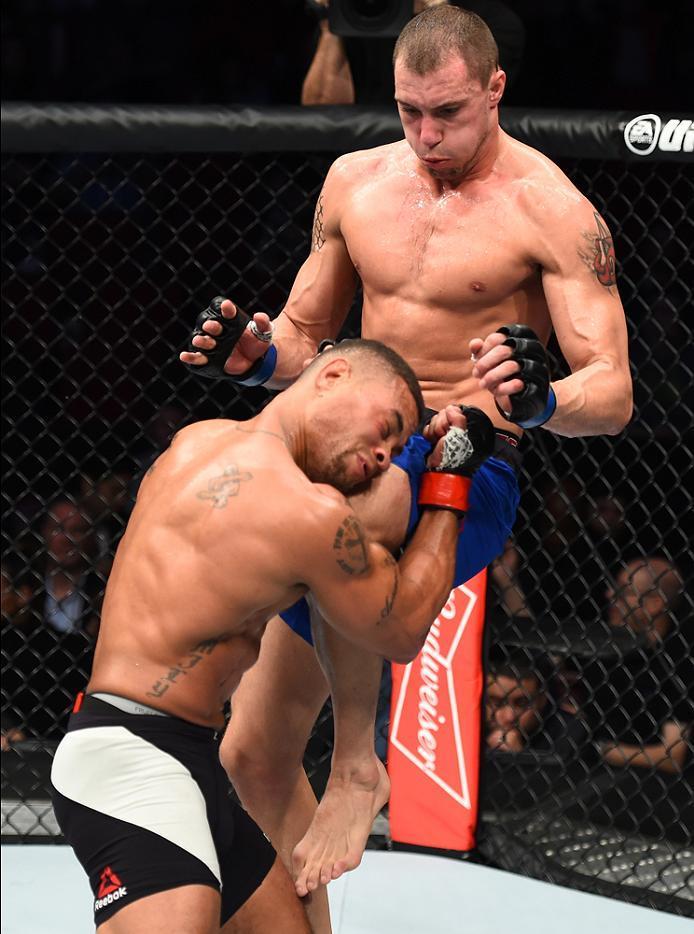 HOUSTON, TX - FEBRUARY 04:  (R-L) James Vick knees Abel Trujillo in their lightweight bout during the UFC Fight Night event at the Toyota Center on February 4, 2017 in Houston, Texas. (Photo by Jeff Bottari/Zuffa LLC/Zuffa LLC via Getty Images)