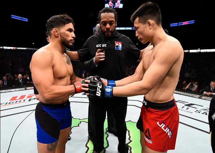 HOUSTON, TX - FEBRUARY 04:  (R-L) Chan Sung Jung of South Korea and Dennis Bermudez touch gloves in their featherweight bout during the UFC Fight Night event at the Toyota Center on February 4, 2017 in Houston, Texas. (Photo by Jeff Bottari/Zuffa LLC/Zuff