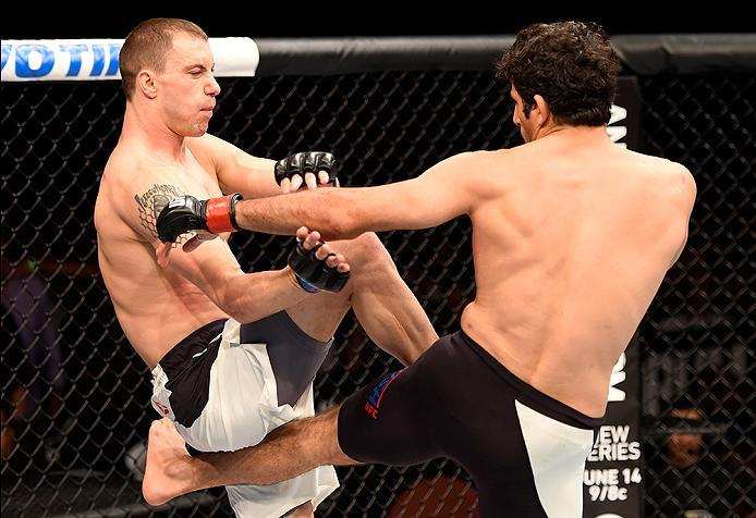 INGLEWOOD, CA - JUNE 04: James Vick and Beneil Darush of Iran exchange blows in their lightweight bout during the UFC 199 event at The Forum on June 4, 2016 in Inglewood, California.  (Photo by Josh Hedges/Zuffa LLC/Zuffa LLC via Getty Images)