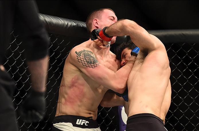 INGLEWOOD, CA - JUNE 04: Beneil Darush of Iran and James Vick exchange blows in their lightweight bout during the UFC 199 event at The Forum on June 4, 2016 in Inglewood, California.  (Photo by Harry How/Zuffa LLC/Zuffa LLC via Getty Images)