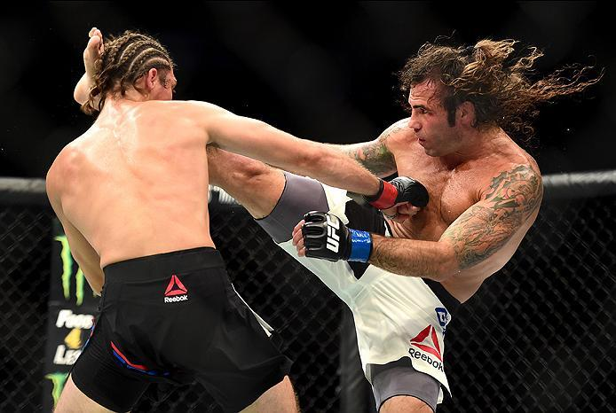 INGLEWOOD, CA - JUNE 04: Clay Guida and Brian Ortega exchange blows in their featherweight bout during the UFC 199 event at The Forum on June 4, 2016 in Inglewood, California.  (Photo by Harry How/Zuffa LLC/Zuffa LLC via Getty Images)