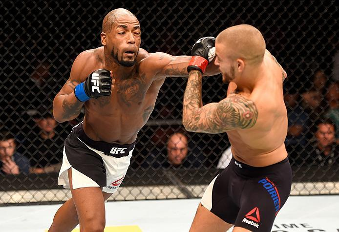 INGLEWOOD, CA - JUNE 04:  Bobby Green punches Dustin Poirier in their lightweight bout during the UFC 199 event at The Forum on June 4, 2016 in Inglewood, California.  (Photo by Josh Hedges/Zuffa LLC/Zuffa LLC via Getty Images)