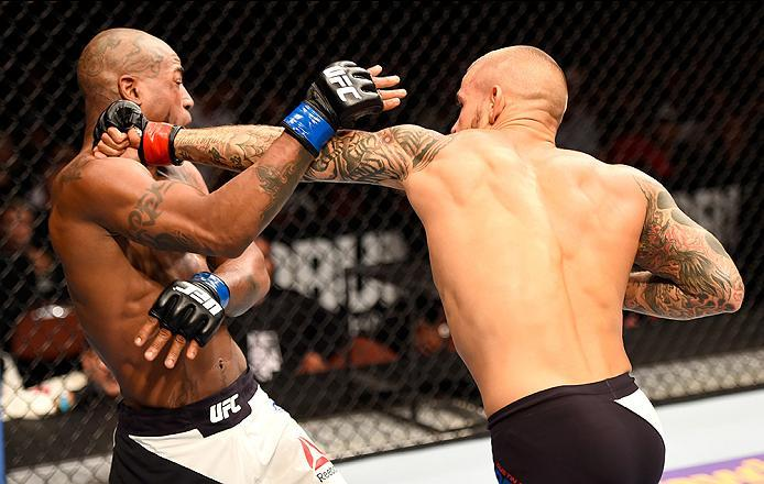 INGLEWOOD, CA - JUNE 04: Dustin Poirier punches Bobby Green in their lightweight bout during the UFC 199 event at The Forum on June 4, 2016 in Inglewood, California.  (Photo by Josh Hedges/Zuffa LLC/Zuffa LLC via Getty Images)