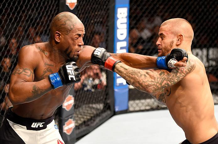 INGLEWOOD, CA - JUNE 04: Bobby Green  and Dustin Poirier exchange blows in their lightweight bout during the UFC 199 event at The Forum on June 4, 2016 in Inglewood, California.  (Photo by Josh Hedges/Zuffa LLC/Zuffa LLC via Getty Images)