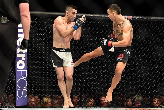 INGLEWOOD, CA - JUNE 04:  Max Holloway kicks Ricardo Lamas in their featherweight bout during the UFC 199 event at The Forum on June 4, 2016 in Inglewood, California.  (Photo by Harry How/Zuffa LLC/Zuffa LLC via Getty Images)