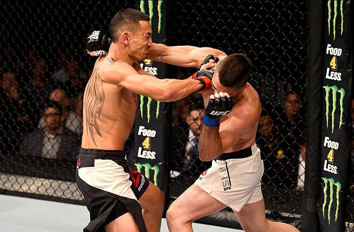 INGLEWOOD, CA - JUNE 04: Max Holloway and Ricardo Lamas exchange blows in their featherweight bout during the UFC 199 event at The Forum on June 4, 2016 in Inglewood, California.  (Photo by Josh Hedges/Zuffa LLC/Zuffa LLC via Getty Images)