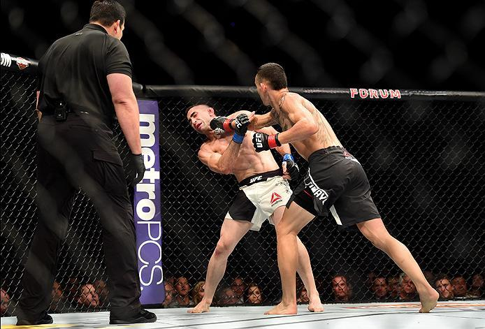 INGLEWOOD, CA - JUNE 04:  Max Holloway lands a right punch to Ricardo Lamas in their featherweight bout during the UFC 199 event at The Forum on June 4, 2016 in Inglewood, California.  (Photo by Harry How/Zuffa LLC/Zuffa LLC via Getty Images)