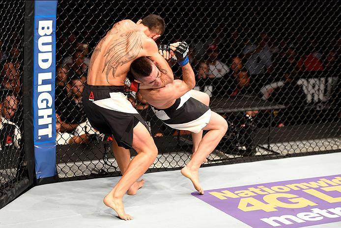 INGLEWOOD, CA - JUNE 04:  Max Holloway wrestles Ricardo Lamas in their featherweight bout during the UFC 199 event at The Forum on June 4, 2016 in Inglewood, California.  (Photo by Josh Hedges/Zuffa LLC/Zuffa LLC via Getty Images)