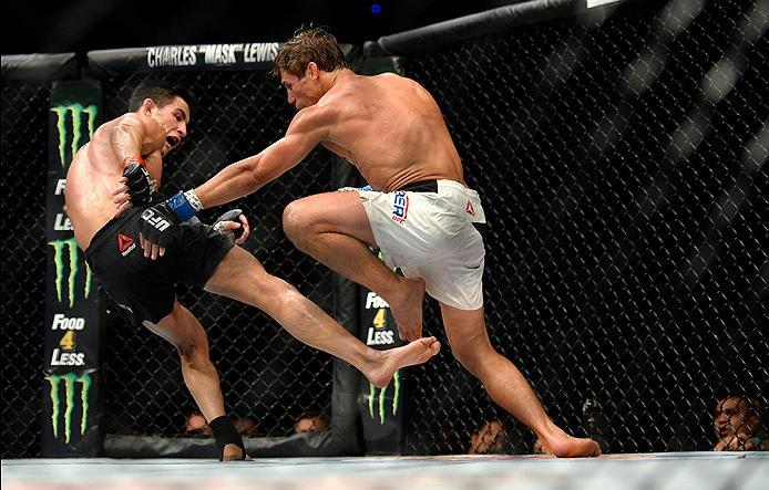 INGLEWOOD, CA - JUNE 04: Urijah Faber and Dominick Cruz exchange blows during the UFC 199 event at The Forum on June 4, 2016 in Inglewood, California.  (Photo by Brandon Magnus/Zuffa LLC/Zuffa LLC via Getty Images)