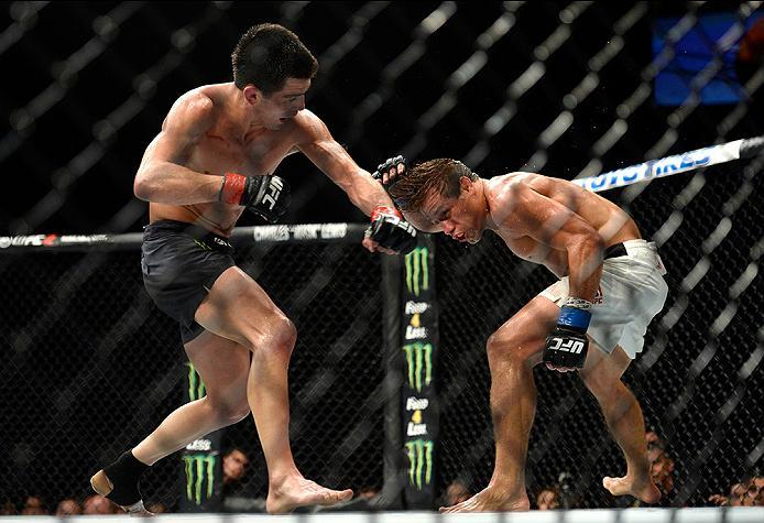 INGLEWOOD, CA - JUNE 04: Dominick Cruz throws a left punch at Urijah Faber during the UFC 199 event at The Forum on June 4, 2016 in Inglewood, California.  (Photo by Brandon Magnus/Zuffa LLC/Zuffa LLC via Getty Images)