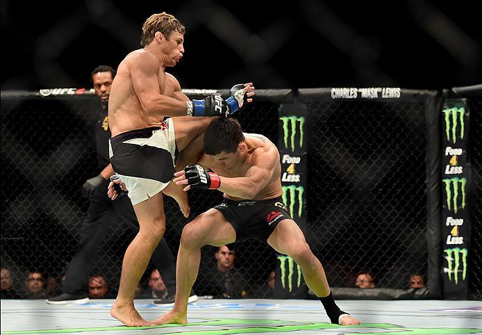 INGLEWOOD, CA - JUNE 04: Urijah Faber knees Dominick Cruz in their UFC bantamweight championship bout during the UFC 199 event at The Forum on June 4, 2016 in Inglewood, California.  (Photo by Harry How/Zuffa LLC/Zuffa LLC via Getty Images)