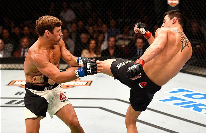 INGLEWOOD, CA - JUNE 04:  Dominick Cruz kicks Urijah Faber in their UFC bantamweight championship bout during the UFC 199 event at The Forum on June 4, 2016 in Inglewood, California.  (Photo by Josh Hedges/Zuffa LLC/Zuffa LLC via Getty Images)
