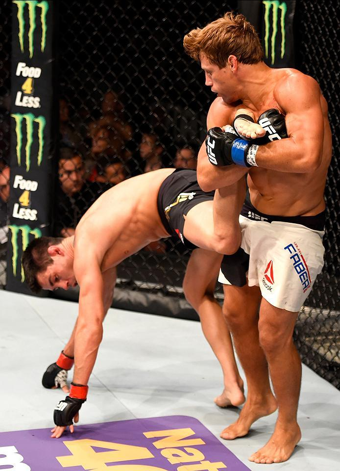 INGLEWOOD, CA - JUNE 04:  Urijah Faber holds Dominick Cruz in their UFC bantamweight championship bout during the UFC 199 event at The Forum on June 4, 2016 in Inglewood, California.  (Photo by Josh Hedges/Zuffa LLC/Zuffa LLC via Getty Images)