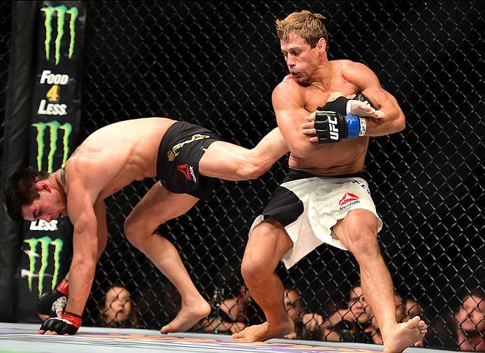 INGLEWOOD, CA - JUNE 04: Urijah Faber holds the leg of Dominick Cruz in their UFC bantamweight championship bout during the UFC 199 event at The Forum on June 4, 2016 in Inglewood, California.  (Photo by Harry How/Zuffa LLC/Zuffa LLC via Getty Images)