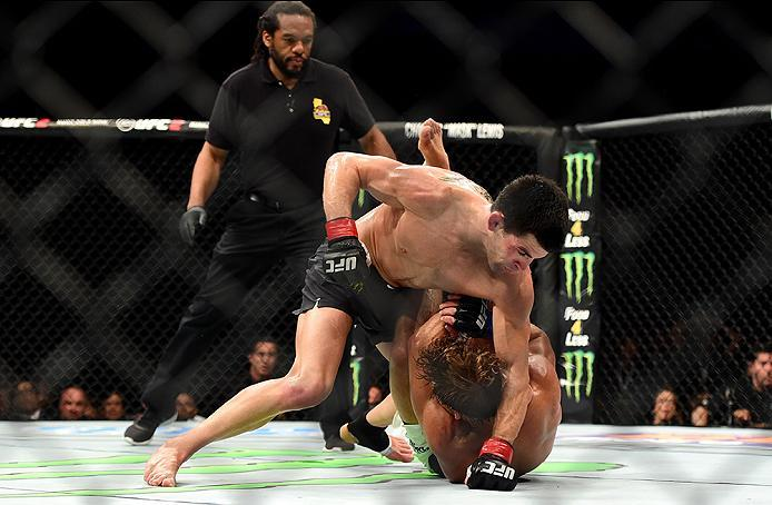 INGLEWOOD, CA - JUNE 04:  Dominick Cruz punches Urijah Faber in their UFC bantamweight championship bout during the UFC 199 event at The Forum on June 4, 2016 in Inglewood, California.  (Photo by Harry How/Zuffa LLC/Zuffa LLC via Getty Images)