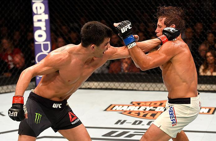 INGLEWOOD, CA - JUNE 04: Dominick Cruz punches Urijah Faber in their UFC bantamweight championship bout during the UFC 199 event at The Forum on June 4, 2016 in Inglewood, California.  (Photo by Josh Hedges/Zuffa LLC/Zuffa LLC via Getty Images)