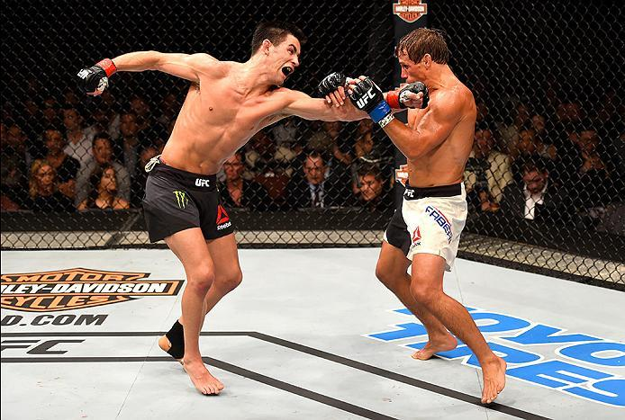 INGLEWOOD, CA - JUNE 04:  Dominick Cruz throws a left punch at Urijah Faber in their UFC bantamweight championship bout during the UFC 199 event at The Forum on June 4, 2016 in Inglewood, California.  (Photo by Josh Hedges/Zuffa LLC/Zuffa LLC via Getty Im