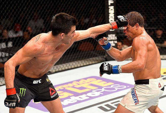 INGLEWOOD, CA - JUNE 04: Dominick Cruz throws a left punch at Urijah Faber in their UFC bantamweight championship bout during the UFC 199 event at The Forum on June 4, 2016 in Inglewood, California.  (Photo by Josh Hedges/Zuffa LLC/Zuffa LLC via Getty Ima