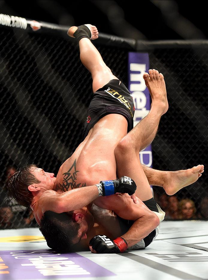 INGLEWOOD, CA - JUNE 04:  Dominick Cruz wrestles Urijah Faber to the ground in their UFC bantamweight championship bout during the UFC 199 event at The Forum on June 4, 2016 in Inglewood, California.  (Photo by Harry How/Zuffa LLC/Zuffa LLC via Getty Imag