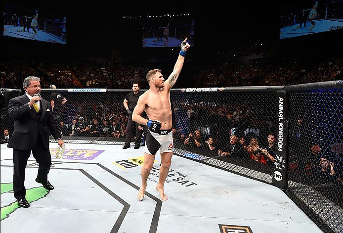 INGLEWOOD, CA - JUNE 04:  Michael Bisping of England celebrates after his first round knockout win against Luke Rockhold in their UFC middleweight championship bout during the UFC 199 event at The Forum on June 4, 2016 in Inglewood, California.  (Photo by