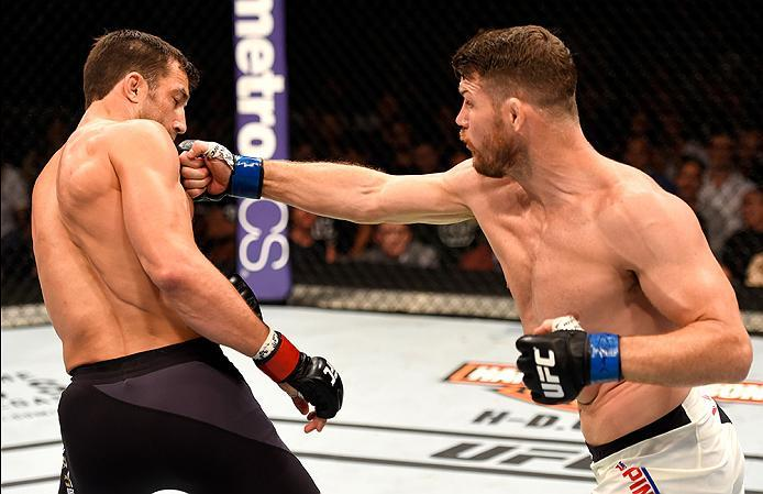 INGLEWOOD, CA - JUNE 04:  Michael Bisping of England punches Luke Rockhold in their UFC middleweight championship bout during the UFC 199 event at The Forum on June 4, 2016 in Inglewood, California.  (Photo by Josh Hedges/Zuffa LLC/Zuffa LLC via Getty Ima