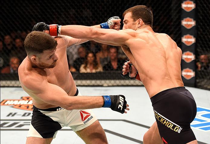 INGLEWOOD, CA - JUNE 04:  Luke Rockhold throws a left punch at Michael Bisping of England in their UFC middleweight championship bout during the UFC 199 event at The Forum on June 4, 2016 in Inglewood, California.  (Photo by Josh Hedges/Zuffa LLC/Zuffa LL