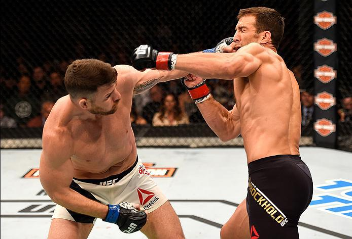 INGLEWOOD, CA - JUNE 04: Michael Bisping throws a left punch against Luke Rockhold in their UFC middleweight championship bout during the UFC 199 event at The Forum on June 4, 2016 in Inglewood, California.  (Photo by Josh Hedges/Zuffa LLC/Zuffa LLC via G