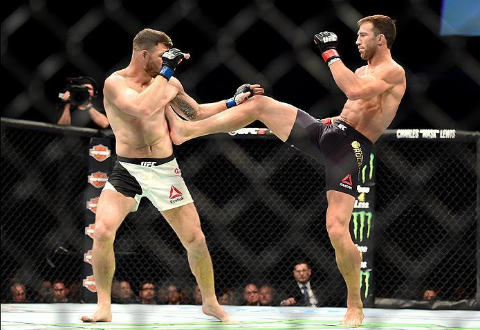 INGLEWOOD, CA - JUNE 04:  Luke Rockhold kicks Michael Bisping of England in their UFC middleweight championship bout during the UFC 199 event at The Forum on June 4, 2016 in Inglewood, California.  (Photo by Harry How/Zuffa LLC/Zuffa LLC via Getty Images)