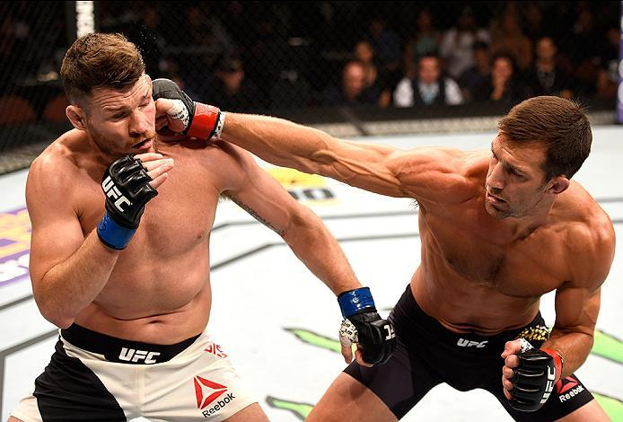 INGLEWOOD, CA - JUNE 04: Luke Rockhold throws a right punch against Michael Bisping of England in their UFC middleweight championship bout during the UFC 199 event at The Forum on June 4, 2016 in Inglewood, California.  (Photo by Josh Hedges/Zuffa LLC/Zuf