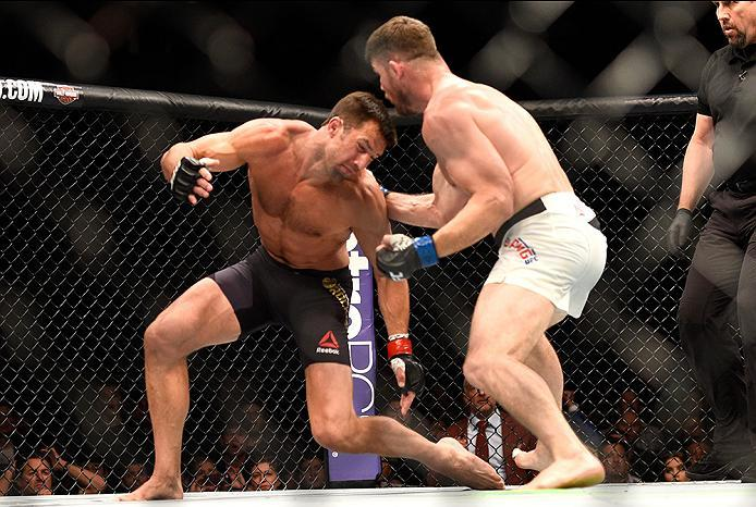 INGLEWOOD, CA - JUNE 04:  Michael Bisping of England punches Luke Rockhold during the UFC 199 event at The Forum on June 4, 2016 in Inglewood, California.  (Photo by Jeff Bottari/Zuffa LLC/Zuffa LLC via Getty Images)