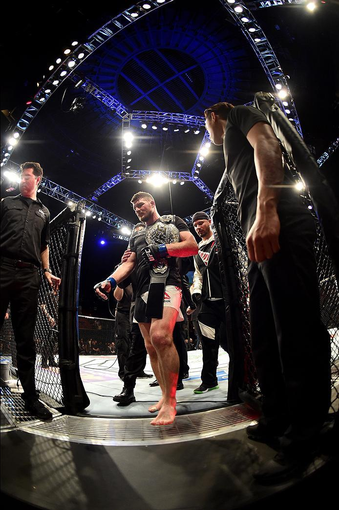 INGLEWOOD, CA - JUNE 04: Michael Bisping of England leaves the Octagon after his first round knockout win against Luke Rockhold in their UFC middleweight championship bout during the UFC 199 event at The Forum on June 4, 2016 in Inglewood, California.  (P