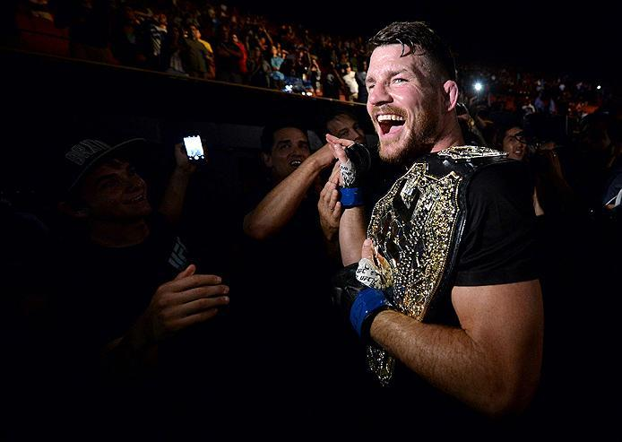 INGLEWOOD, CA - JUNE 04:  Michael Bisping of England celebrates with his title belt after his first round knockout win against Luke Rockhold during the UFC 199 event at The Forum on June 4, 2016 in Inglewood, California.  (Photo by Brandon Magnus/Zuffa LL