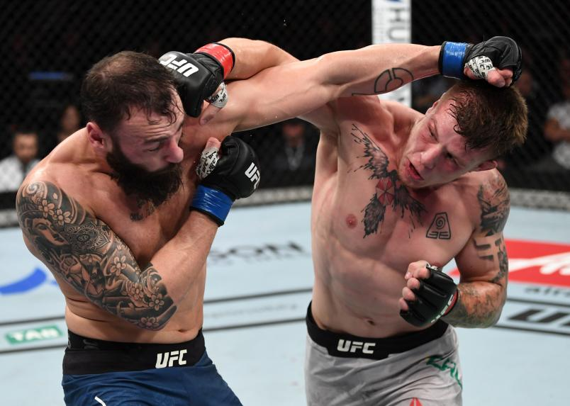 ADELAIDE, AUSTRALIA - DECEMBER 02: (R-L) Jimmy Crute of Australia punches Paul Craig of Scotland in their light heavyweight bout during the UFC Fight Night event inside Adelaide Entertainment Centre on December 2, 2018 in Adelaide, Australia. (Photo by Jeff Bottari/Zuffa LLC/Zuffa LLC via Getty Images)
