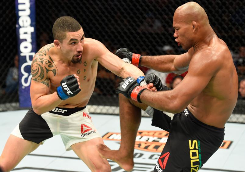 KANSAS CITY, MO - APRIL 15: (L-R) Robert Whittaker of New Zealand punches Jacare Souza of Brazil in their middleweight fight during the UFC Fight Night event at Sprint Center on April 15, 2017 in Kansas City, Missouri. (Photo by Josh Hedges/Zuffa LLC/Zuffa LLC via Getty Images)