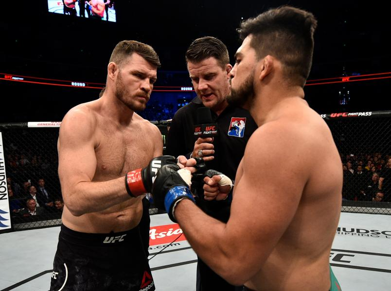 SHANGHAI, CHINA - NOVEMBER 25: (L-R) Opponents Michael Bisping of England and Kelvin Gastelum face offprior to their middleweight bout during the UFC Fight Night event inside the Mercedes-Benz Arena on November 25, 2017 in Shanghai, China. (Photo by Brandon Magnus/Zuffa LLC via Getty Images)