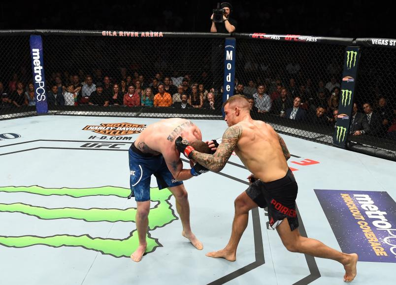 GLENDALE, AZ - APRIL 14: (R-L) Dustin Poirier punches Justin Gaethje in their lightweight fight during the UFC Fight Night event at the Gila Rivera Arena on April 14, 2018 in Glendale, Arizona. (Photo by Josh Hedges/Zuffa LLC/Zuffa LLC via Getty Images)