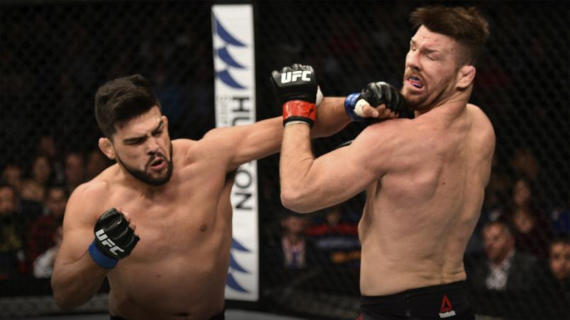 SHANGHAI, CHINA - NOVEMBER 25: Kelvin Gastelum punches Michael Bisping of England in their middleweight bout during the UFC Fight Night event inside the Mercedes-Benz Arena on November 25, 2017 in Shanghai, China. (Photo by Brandon Magnus/Zuffa LLC via Getty Images)