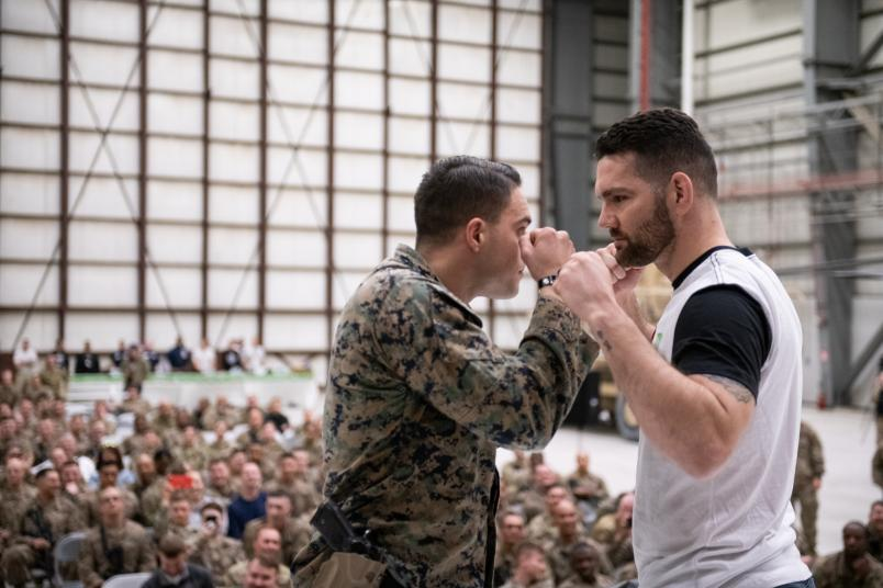 Chris Weidman faces off with a member of the United States military during a portion of his USO Tour visit overseas (DoD Photo by U.S. Army Sgt. James K. McCann).