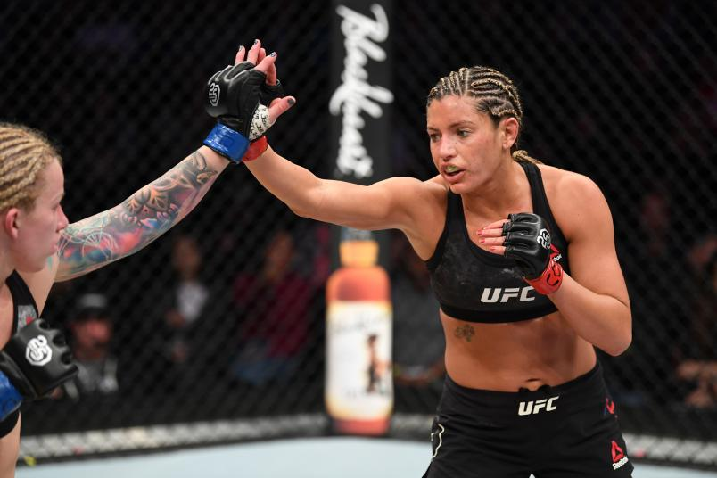 DENVER, CO - NOVEMBER 10: (R-L) Ashley Yoder and Amanda Cooper touch gloves to the start of round two in their women's strawweight bout during the UFC Fight Night event inside Pepsi Center on November 10, 2018 in Denver, Colorado. (Photo by Josh Hedges/Zuffa LLC/Zuffa LLC via Getty Images)