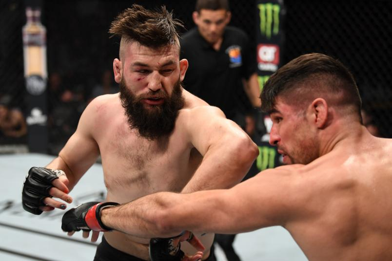 PHOENIX, ARIZONA - FEBRUARY 17: (L-R) Bryan Barberena elbows Vicente Luque in their welterweight bout during the UFC Fight Night event at Talking Stick Resort Arena on February 17, 2019 in Phoenix, Arizona. (Photo by Josh Hedges/Zuffa LLC/Zuffa LLC via Getty Images)