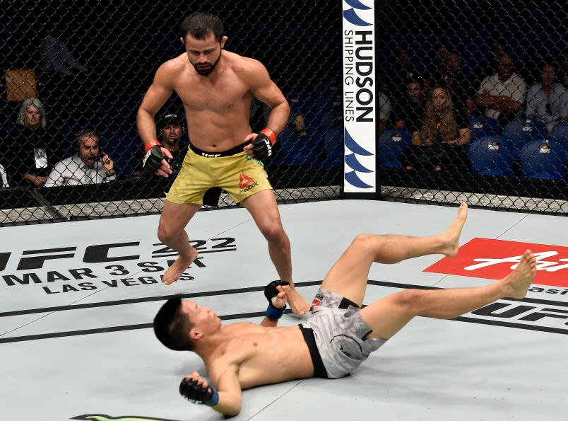 FEBRUARY 11: (L-R) Jussier Formiga of Brazil knocks down Ben Nguyen in their flyweight bout during the UFC 221 event at Perth Arena on February 11, 2018 in Perth, Australia. (Photo by Jeff Bottari/Zuffa LLC via Getty Images)
