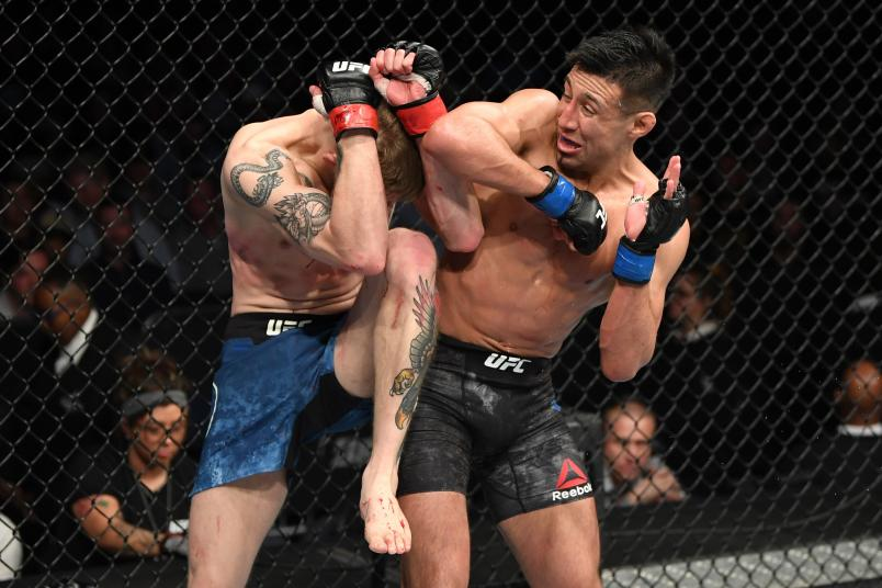 NASHVILLE, TENNESSEE - MARCH 23: (R-L) Chris Gutierrez elbows Ryan MacDonald in their bantamweight bout during the UFC Fight Night event at Bridgestone Arena on March 23, 2019 in Nashville, Tennessee. (Photo by Jeff Bottari/Zuffa LLC/Zuffa LLC via Getty Images)