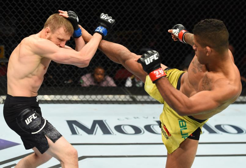 Gilbert Burns of Brasil kicks Dan Moret in their lightweight fight during the UFC Fight Night event at the Gila Rivera Arena on April 14, 2018 in Glendale, Arizona. (Photo by Josh Hedges/Zuffa LLC via Getty Images)
