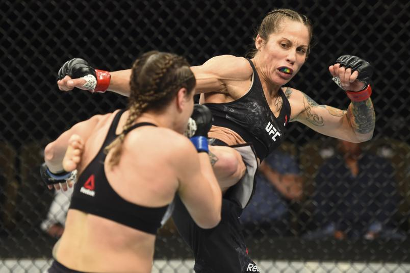 Liz Carmouche kicks Jennifer Maia of Brazil in their women's flyweight fight during the UFC Fight Night event inside CenturyLink Arena on July 14, 2018 in Boise, Idaho. (Photo by Josh Hedges/Zuffa LLC via Getty Images)