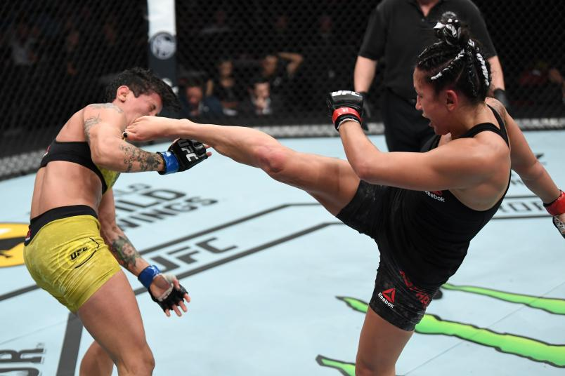 SUNRISE, FL - APRIL 27: (R-L) Carla Esparza kicks Virna Jandiroba of Brazil in their women's strawweight bout during the UFC Fight Night event at BB&T Center on April 27, 2019 in Sunrise, Florida. (Photo by Jeff Bottari/Zuffa LLC/Zuffa LLC via Getty Images)